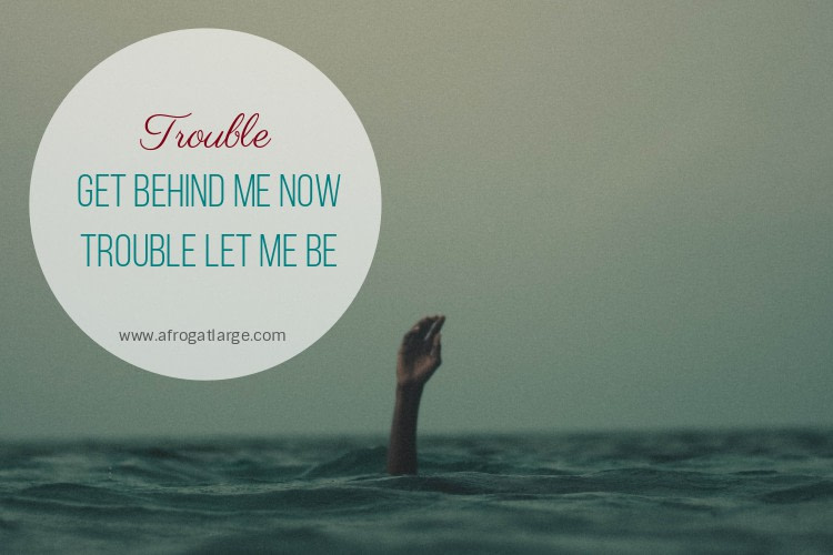 hand sticking out of a grey ocean, with the blog title 'trouble get behind me now, trouble let me be'
