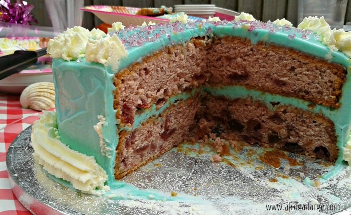 pink birthday cake with blue icing