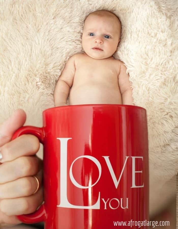 baby in red mug